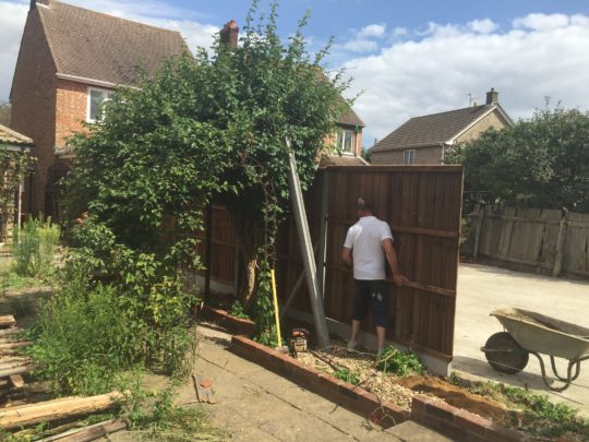 Paul installing New Fence Panels
