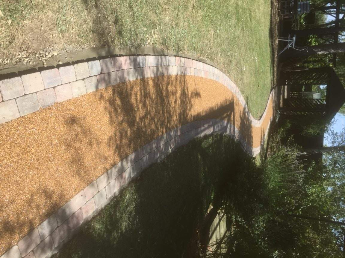 Our client decided they wanted us to install a Resin and Block pathway from their patio area leading through the garden