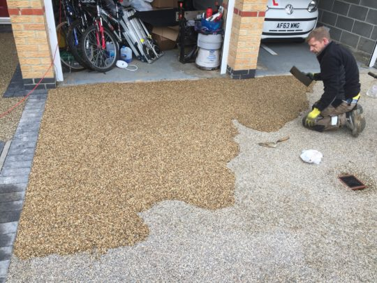 Golden Quartz Resin Driveway Overlay being installed