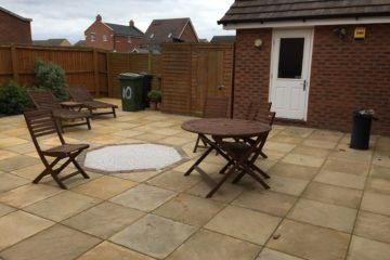Rear Garden Entirely Slabbed with Resin Feature