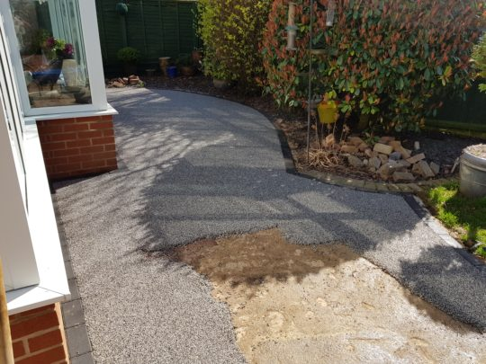 Resin Being installed to replace block paved patio