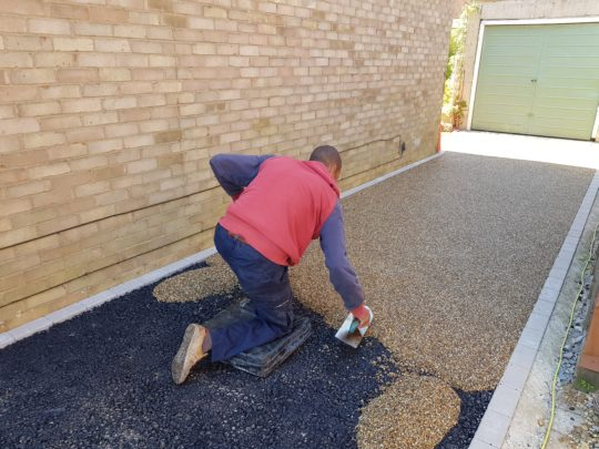 Darren trowelling the Resin in Mead Way Market Deeping