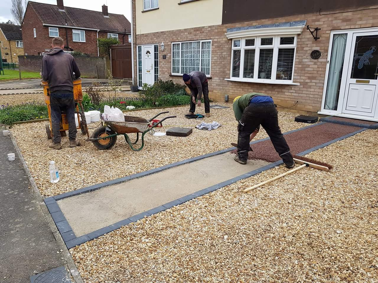 Resin Being Trowelled onto Path
